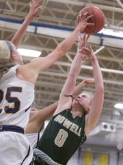 Howell's Paige Johnson (0) has a shot blocked by Hartland's