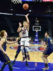 Milford's Dominic Dawson (23) goes into the lane for