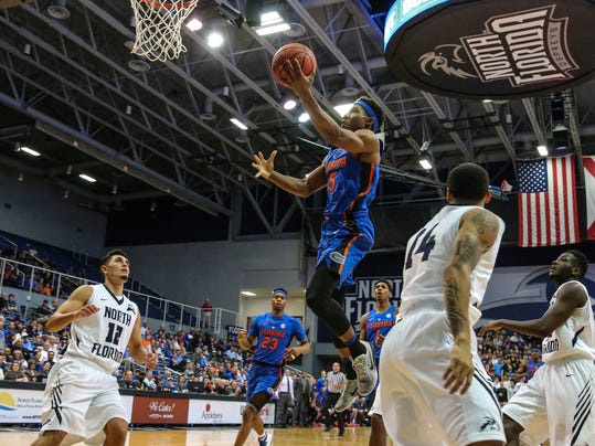 Florida guard KeVaughn Allen (5) shoots during the first half of an NCAA college basketball game against North Florida in Jacksonville, Fla., Thursday, Dec. 1, 2016. (AP Photo/Gary McCullough)