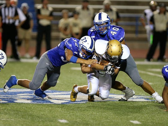 Lake View's players tackle an Andrews Mustang during