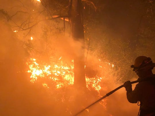 Crews battle a fast-moving fire near Fairview Avenue in Goleta on Friday night.