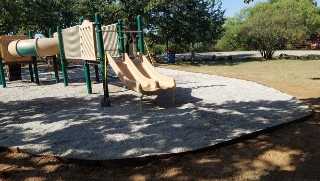 A $1,000 donation was used to buy edging to keep soft-surface gravel around new playground equipment at Eastland's City Park.