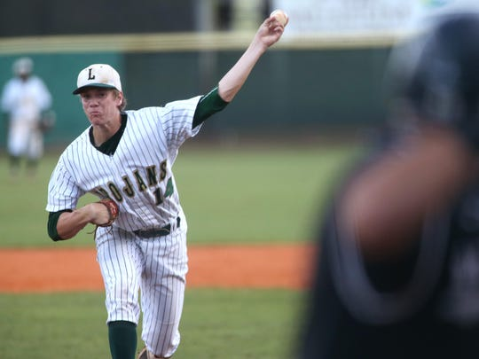 Lincoln's Austin Pollock pitches a complete game shutout of Wharton in the Trojans 2-0 Region 1-8A final win at Lincoln High School on Friday.