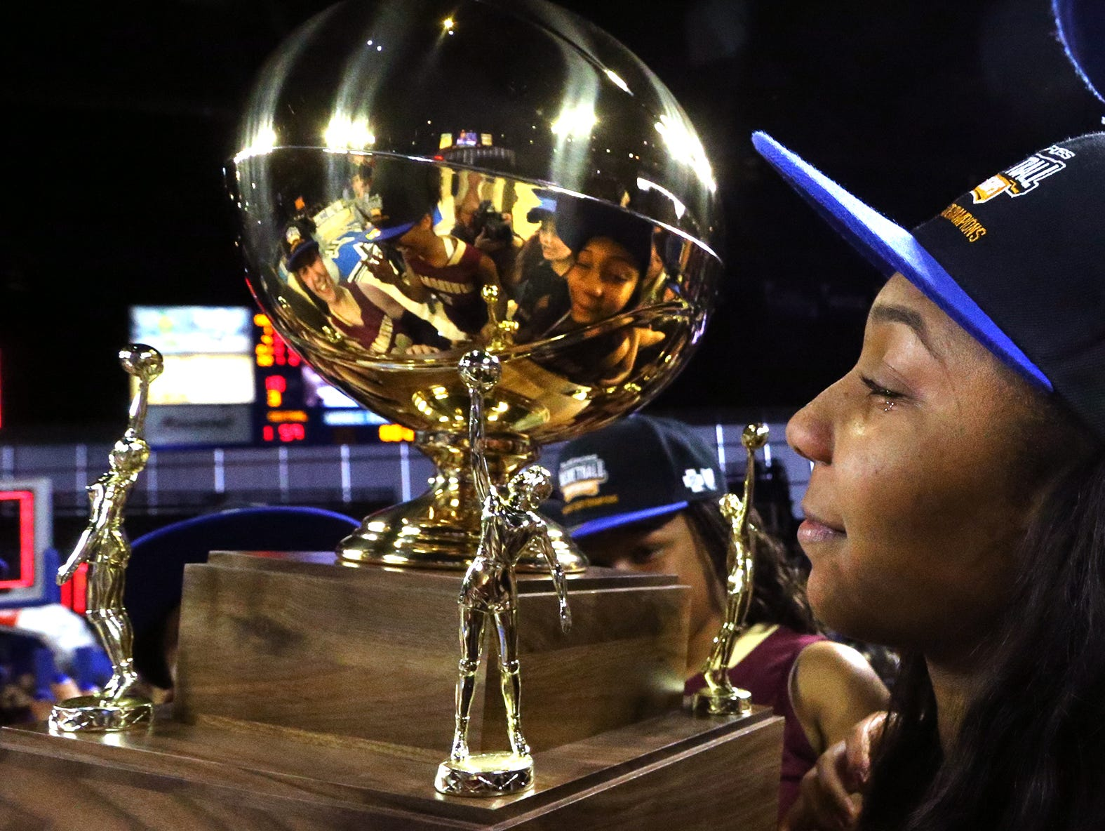 Riverdale's Anastasia Hayes (3) has a tear in her eye as she holds up the Championship Trophy with her teammates as they celebrate their victory over Memphis Central in the Class AAA State Tournament on Saturday, March 11, 2017.