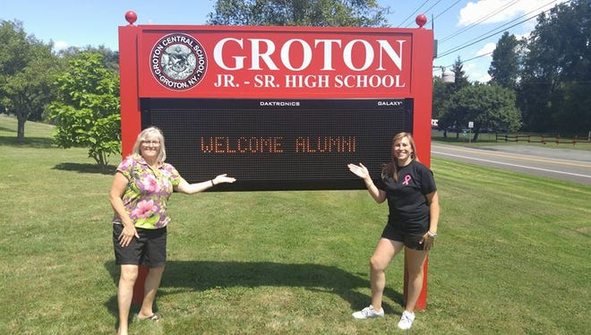 Linda Park Van Berkom, left, and Lindsay Van Berkom in front of new sign at Groton High School. The two attended Groton's 20th annual all-alumni reunion picnic last weekend.