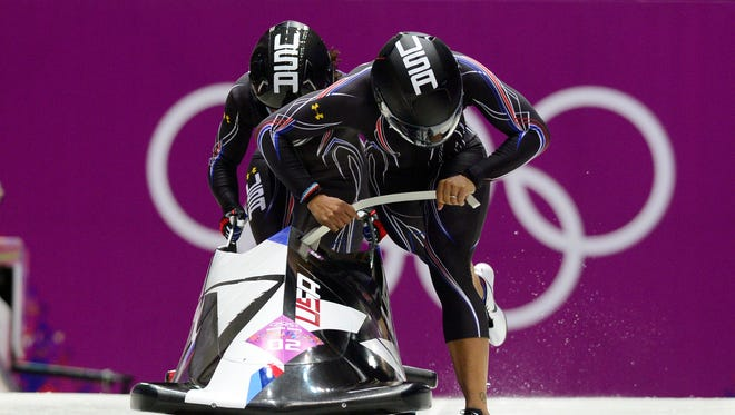 USA1 piloted by Elana Meyers with Lauryn Williams set a track record in the first heat of the women's bobsled.