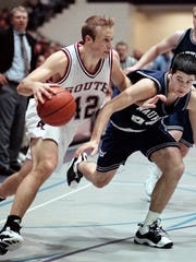 Waukesha South's Julian Swartz moves toward the basket late in the fourth with Waukesha North's Nick Kilton pressuring him in 1999.