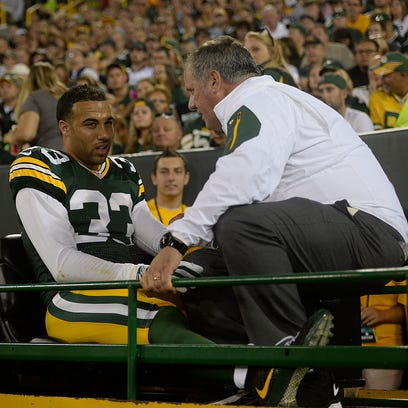 Green Bay Packers' Micah Hyde leaves the game after