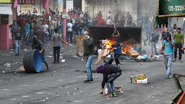 Palestinians clash with Israeli security forces near