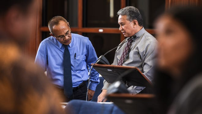 Sens. James Espaldon, left, and Tom Ada, work out details of a bill during a break in session at the Guam Congress Building in Hagåtña on Tuesday, May 23, 2017.