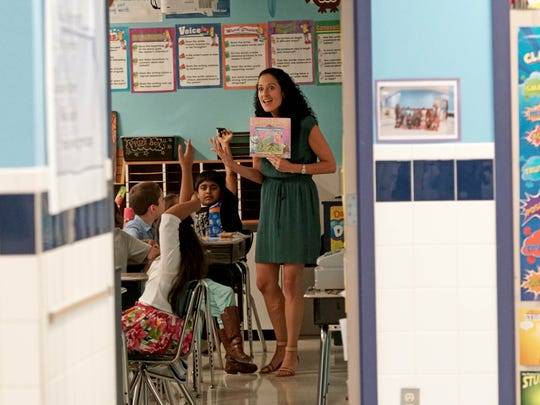 Danielle Rash, a third-grade inclusion teacher at Olive B. Loss, reads to her class during a lesson at the school that was just named a national Blue Ribbon school.