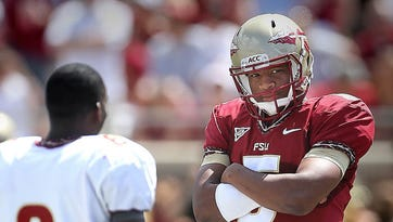 During the pre-game coin toss, Jameis Winston gave opposing players a tough guy pose. Jameis Winston led the Garnet team to a 31-14 win in the Spring Game on Saturday afternoon, April 12, 2014.