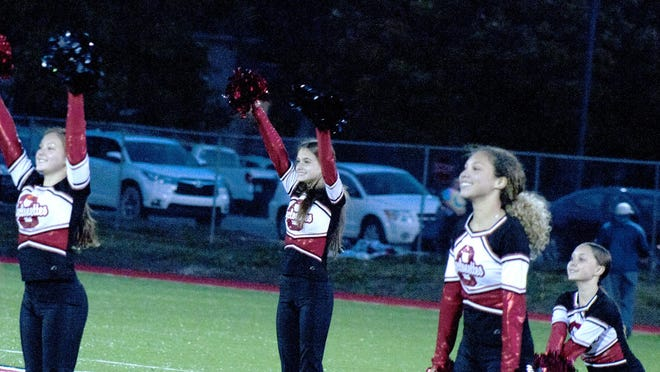The Ottawa High School dance team -- the Cyclonettes -- perform during halftime of Thursday's soccer match between Ottawa and Eudora.