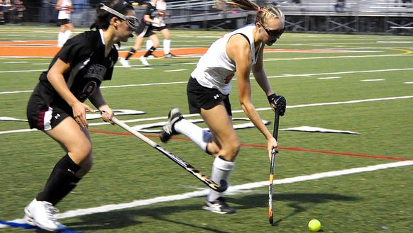 Mamaroneck's Caroline Allen moves the ball up the sideline