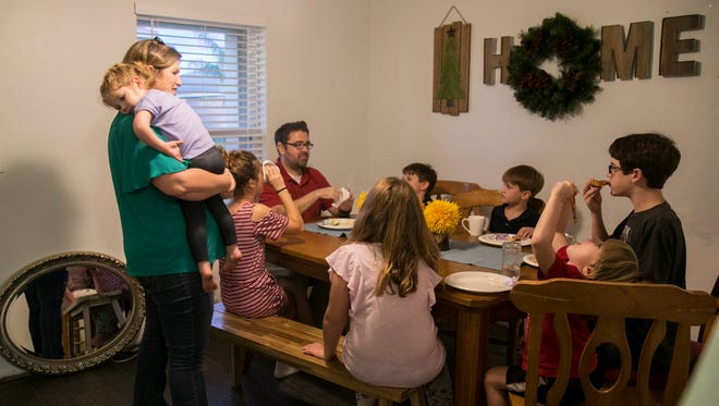 The Kain family eats a pizza dinner after one of Mike's doctor appointments recently. They have been through a lot in the last two years. Mike, who was born with kidney disease and had a kidney transplant from his dad after high school, got sick again in April 2016. He then spent more than a year on dialysis as he continued to work full time and complete his masters degree. In September 2017, he got a new kidney from his sister Dayna.