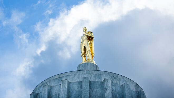 The Oregon Pioneer stands sentinel atop the Oregon State Capitol.
