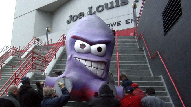 """Al the Octopus"" is taken off a flat bed truck by several Olympia Entertainment workers and carried up the steps of the West entrance of Joe Louis Arena on April 13, 2010."
