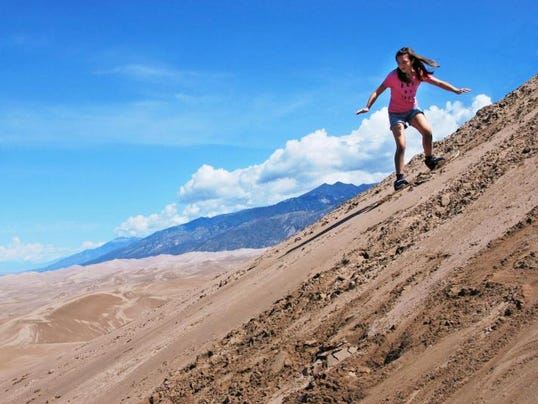 635751066479159155-Sandboard-Colorado-4-Girl-Sandboarding-High-Dune.NPS