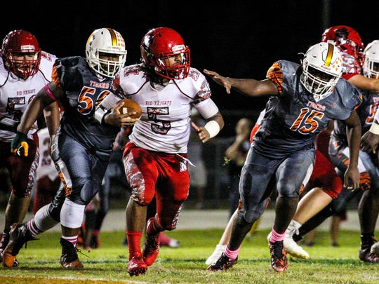North Fort Myers' Fa'Najae Gotay gained yards on Dunbar's Justin Michel. Game highlights from the North Fort Myers at Dunbar football game.