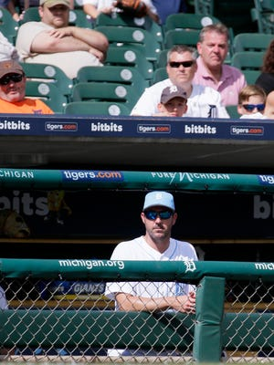 Tigers pitcher Justin Verlander and fans watch the ninth inning of the Tigers' 9-1 loss to the Rays Sunday at Comerica Park.