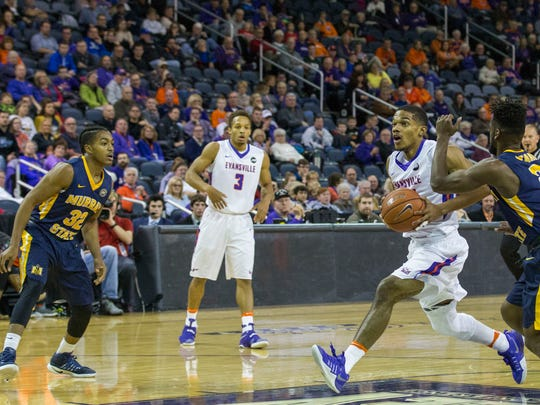 UE's Duane Gibson (25) carries the ball to the basket after a breakaway from Murray State during Saturday afternoon's game at the Ford Center.