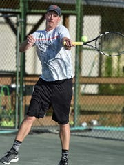 Six-time champ Jay Harris fires a forehand in his loss