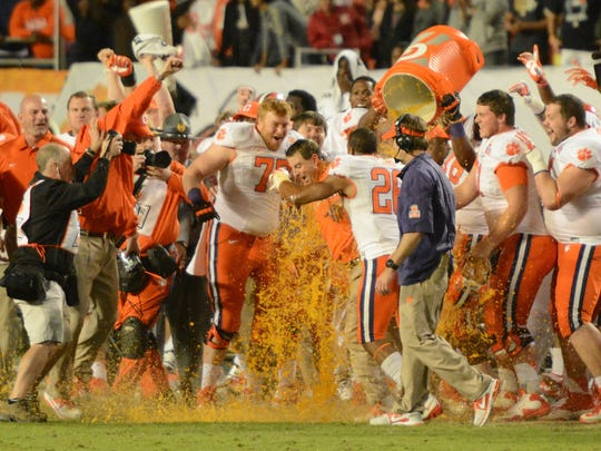Clemson coach Dabo Swinney gets doused with Gatorade after the 2014 Orange Bowl at Sun Life Stadium. Clemson defeated Ohio State 40-35.