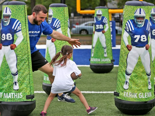Indianapolis Colts quarterback Andrew Luck plays with