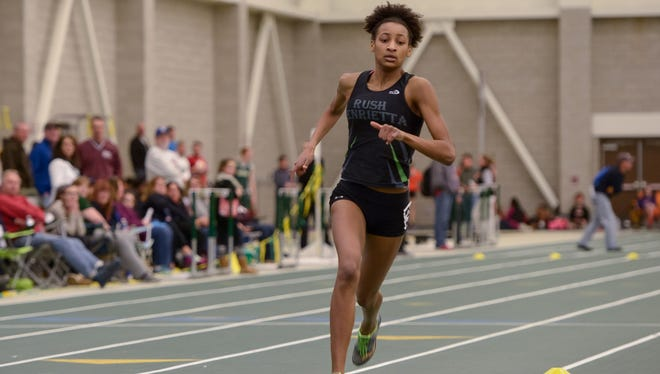 Rush-Henrietta's Sammy Watson, shown here running a 600-meter race at The College at Brockport last year, also shares the national high school sprint medley relay record.