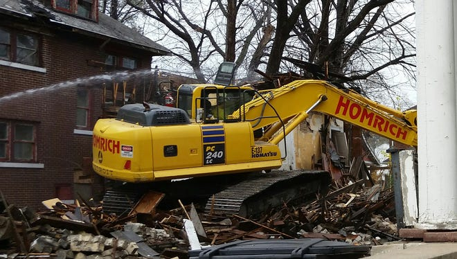 Contractors demolish a vacant, abandoned home at 1960 Calvert in Dexter-Linwood area of Detroit in November