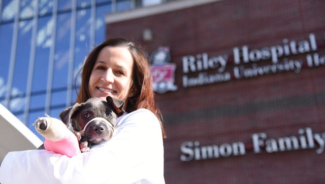 Dr. Tara Harris of Riley Hospital for Children helps abused animals through her animal-rescue group, Every Dog Counts.