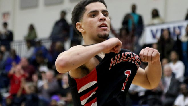 Hughes'  Dwayne Rosardo reacts during the Big Red's win over Woodward in the regional semifinal, Thursday, March 15, 2018.