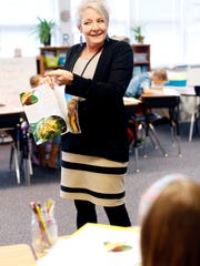 Substitute teacher Maggie Skroski works with Bell Elementary students March 20, 2017.