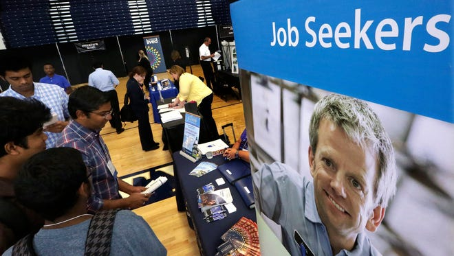 Students attend The Foot in the Door Career Fair at the University of Illinois in Springfield, Ill.