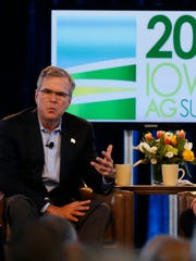 Former Florida Gov. Jeb Bush answers a question from Bruce Rastetter during the Iowa Ag Summit in Des Moines on Saturday.