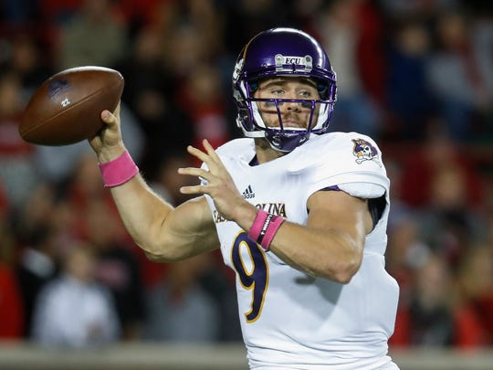FILE - In this Saturday, Oct. 22, 2016, file photo, East Carolina quarterback Philip Nelson throws during the first half of an NCAA college football game against Cincinnati, in Cincinnati. Montana's Brady Gustafson and Nelson are the other quarterbacks in this year's draft. Both have potential to be surprises and enjoy successful careers in the NFL. (AP Photo/John Minchillo, File)
