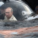POOL ALTERNATIVE CROP OF MOSB205 Russian President Vladimir Putin, foreground, sits on board a bathyscaphe as it plunges into the Black sea along the coast of Sevastopol, Crimea, Tuesday, Aug. 18, 2015. President Vladimir Putin plunged into the Black Sea to see the wreckage of a sunk ancient merchant ship which was found in the end of May. (Alexei Nikolsky/RIA-Novosti, Kremlin Pool Photo via AP)