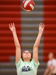 Morgan Holthaus takes part in a drill during volleyball