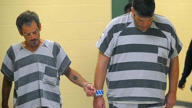 David Farris Chumley, 44, and Jeremy Lee Buchan, 41, are escorted Friday into a Minnehaha County courtrom.