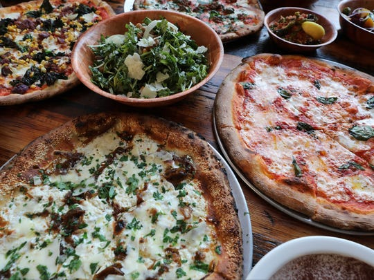 Clockwise from top left, the veggie pizza, meatball
