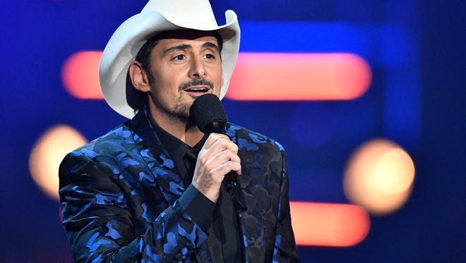 Host Brad Paisley speaks on stage during the CMA Awards on Nov. 8, 2017, at Bridgestone Arena in Nashville.
