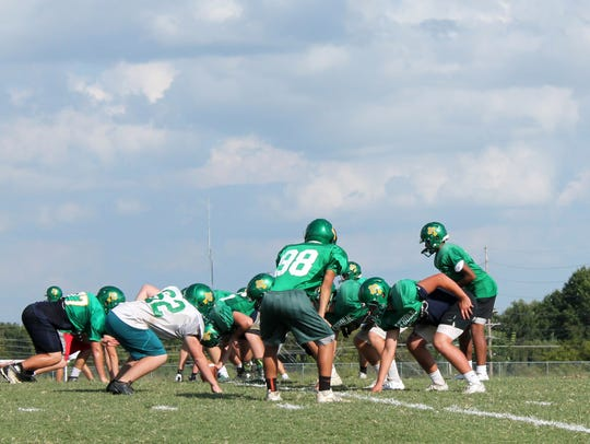 Springfield Catholic's offense lines up in a pistol