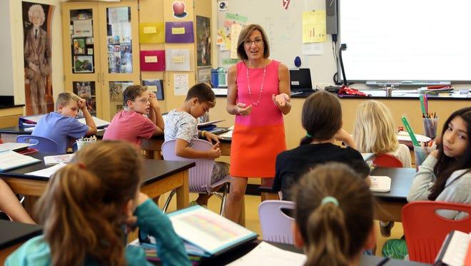 Maria Buckley teaches a sixth-grade science class at Pelham Middle School.