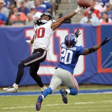 Sep 21, 2014; East Rutherford, NJ, USA; Houston Texans wide receiver DeAndre Hopkins (10) makes a catch against New York Giants cornerback Prince Amukamara (20). The play was negated by a Texans penalty at MetLife Stadium.