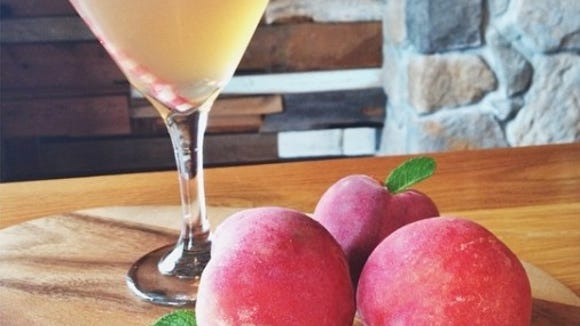 A Peach Cider Martini at Keg & Kitchen features Circle M Peach Cider, Stoli Peach Vodka, St. Elder with white cranberry.