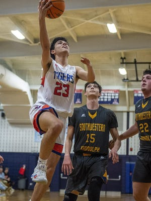 Randleman's Nate Cassidy lays the ball up against Southwestern Randolph in the championship game of the 29th annual The Courier-Tribune Boys Christmas Invitational. Cassidy and the Tigers face a rematch with Jordan-Matthews on Friday. [PJ Ward-Brown for The Courier-Tribune]