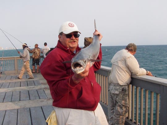 Jerry Gerardi with a king mackerel he caught from the M.B. Miller fishing pier in Panama City Beach during blessedly cooler weather.
