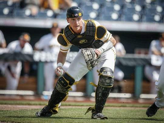 Iowa senior catcher Tyler Cropley fields an Ohio State bunt during the Big 10 Baseball Tournament on Thursday, May 24, 2018, in Omaha, Neb.