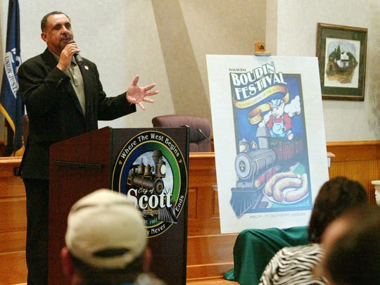 Scott Mayor Purvis Morrison speaks to guests as the inaugural Scott Boudin Festival t-shirt and poster designs are unveiled in 2013 at Scott City Hall.