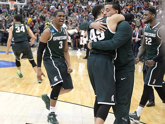 Drew Valentine, right, hugs his brother Denzel after the Spartans' beat Louisville to reach the Final Four in 2015. Drew Valentine was a graduate manager for MSU's team that year.